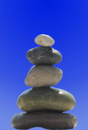 The stack of pebble stones in zen concept on blue photo