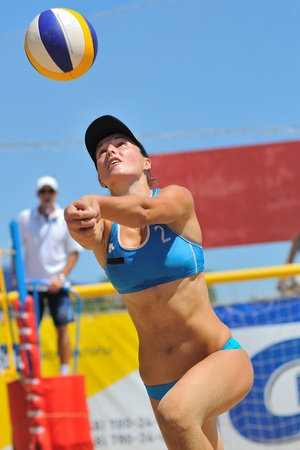 Odessa, Ukraine, July 2010 volleyball player makes a block near the net at the All-Ukrainian championship in volleyball for women