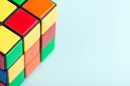 Kyiv, Ukraine - May 17th, 2017: Rubik's cube on the light blue background, top view. Rubik's cube invented by a Hungarian architect Erno Rubik in 1974. Editorial