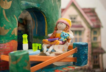 dollhouse: Doll on the balcony