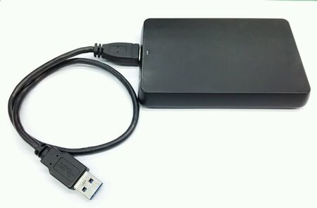 external hard disk drive: Black external hard disk drive with usb cable.