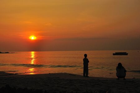 Sunset with child and mon