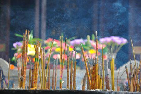 Yellow incense sticks burning at Temple