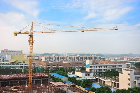 Buildings under construction and cranes under a blue sky Stock Photo