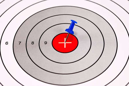 Blue Pin in a Red Centered Target With Crosshair