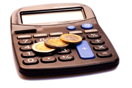 Calculator With Money on an Isolated White Background Stock Photo