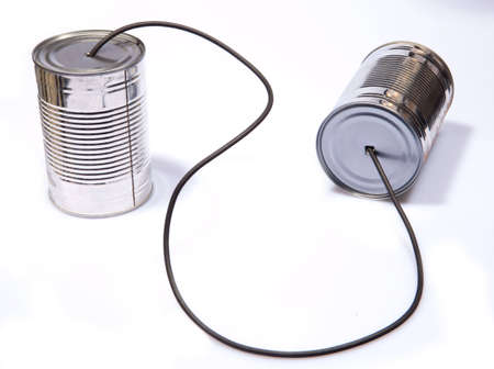 Retro Tin Can Phone Childs Toy on Isolated White Backgound photo