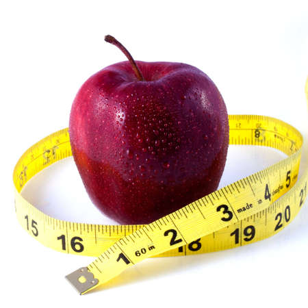 Red Apple and Tape Measure Depicting Weight Loss Concept Stock Photo