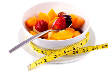Bowl of Fresh Fruit Salad With Tape Measure photo