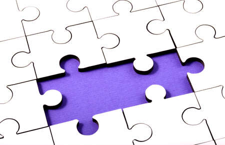 underlay: Jigsaw With Two Pieces Missing Showing Purple Underlay Stock Photo