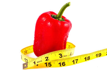 Red Pepper Whit Tape Measure suggesting weight loss Stock Photo