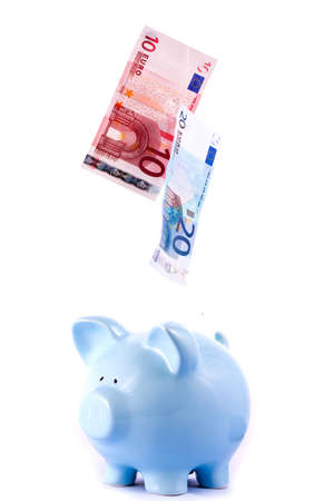 Piggy Bank With Falling Notes on Isolated White Background