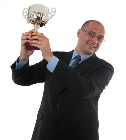 Businessman Holding a trophy on white background Stock Photo
