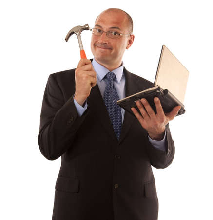 businessman about to smash laptop with a hammer