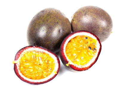 Some passion fruit with one cut in half