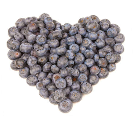 Blueberries in a heart shape on white background Stock Photo