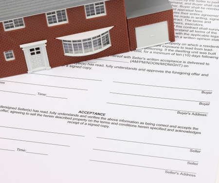 House Contract with model house sitting on contract