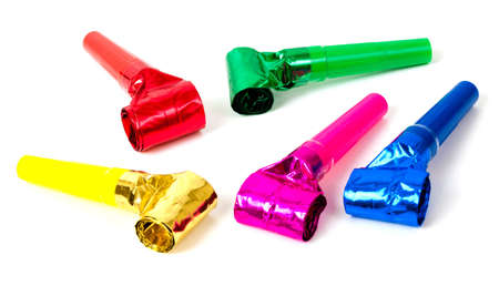 Selection of different colored party blowers on a white background Stock Photo