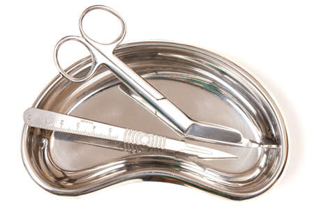 Scalpel and Scissors in stainless steel dish
