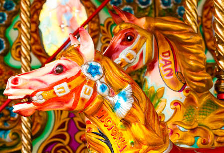 Two Brightly colored carousel horses from a funfair Stock Photo