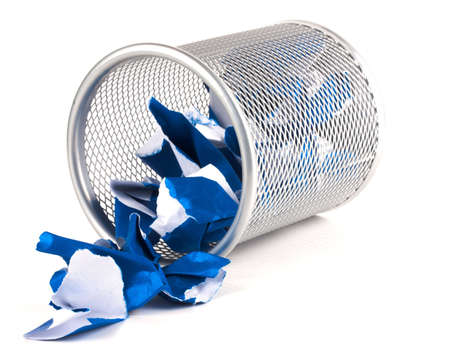 A silver mesh waste paper bin with blue paper spilling from it