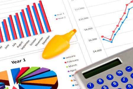 free photos: Different types of charts with a calculator and orange highlighter pen