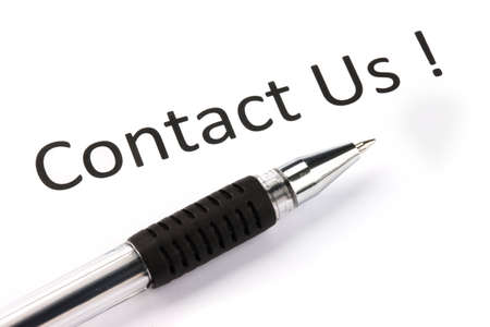 The words Contact us in black on white paper whit a black pen Stock Photo