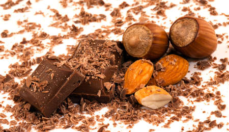 Chocolate pieces with shavings and whole almonds with two in their shells Stock Photo