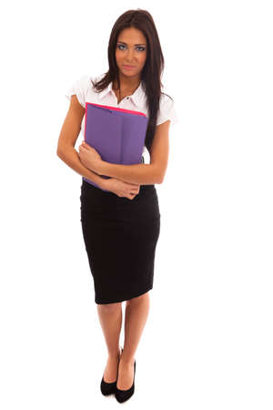 Business woman in a white shirt and black skirt holding brightly colored files