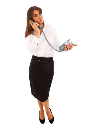 Business Woman in black skirt and white blouse speaking to someone on the telephone Stock Photo - 8626487
