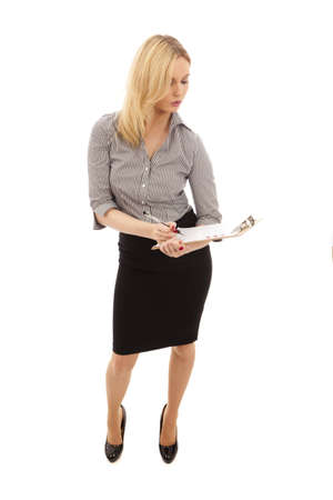 Business Woman in black skirt and white blouse holding clipboard Stock Photo