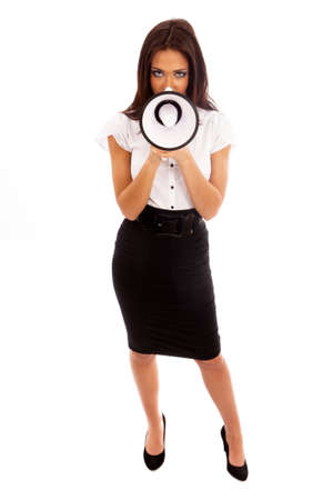 Business Woman in black skirt and white blouse talking through a megaphone Stock Photo