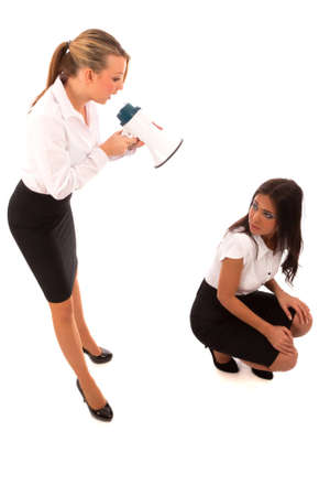 business woman in black skirt and white blouse shouting at someone through a megaphone