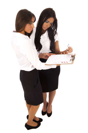 todo: Two business women looking a clipboard with a to-do list
