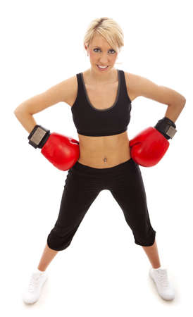 female boxing: A female wearing red boxing gloves with herand on her hips