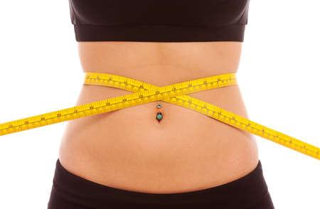 cintas: Una medida de cinta amarilla alrededor de una cintura de mujeres j�venes
