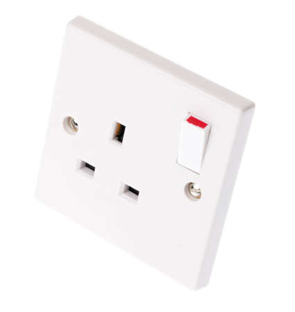 plug in: A UK plug socket with the switch in the on postion Stock Photo