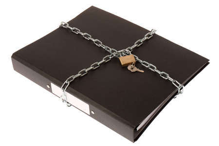 A ring binder wrapped up in a chain and padlock Stock Photo - 9310226