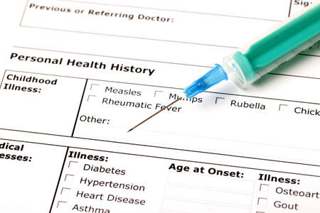 A medical history form with a green syringe