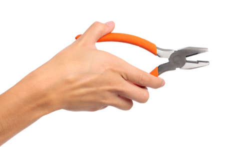 A female hand holding a pair of pliers on an isolated white background Stock Photo