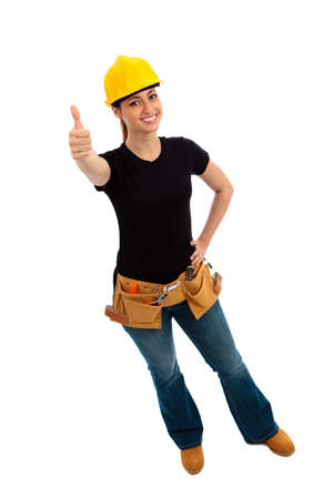 a young female dressed in blue jeans and black top and tool belt giving thumbs up sign  on isolated white background