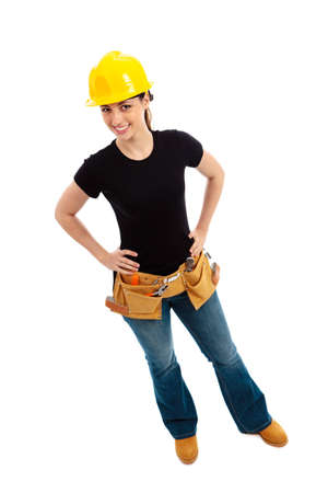 a young female dressed in blue jeans and black top and tool belt and hard hat on isolated white background Stock Photo