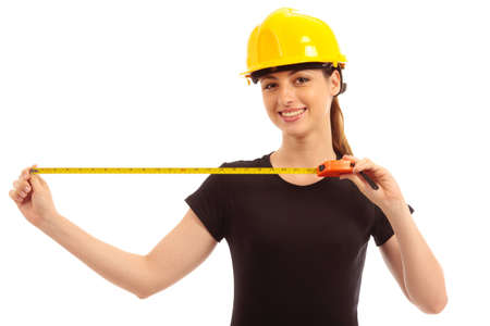 a young female holding a tape measure wearing a safety hat