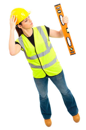 A females dressed in a high visibility jacket holding a spirit level on isloated white background Stock Photo