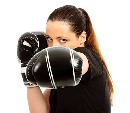 girl punch: A young female wearing black boxing gloves on an isolated white background Stock Photo