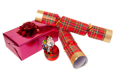 Two chrismas crackers with a present on a white isolated background Stock Photo