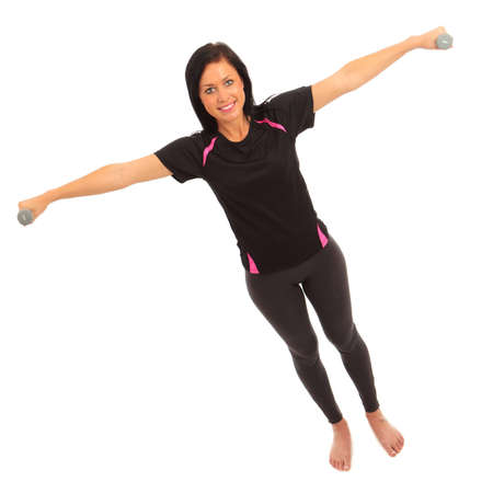 deltoid: A young female dressed in sports clothes performing a dumbell side deltoid raise exercise Stock Photo