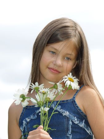 Portrait of young girl with chamomilles Stock Photo