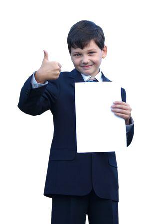 スーツのショーは、親指と笑みを浮かべて、白い背景の上の少年 写真素材