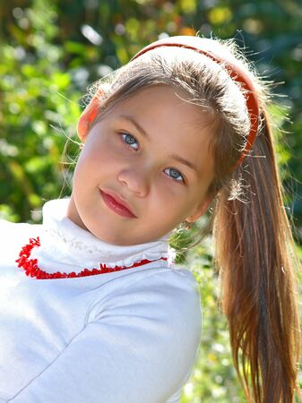 Young girl in white blouse